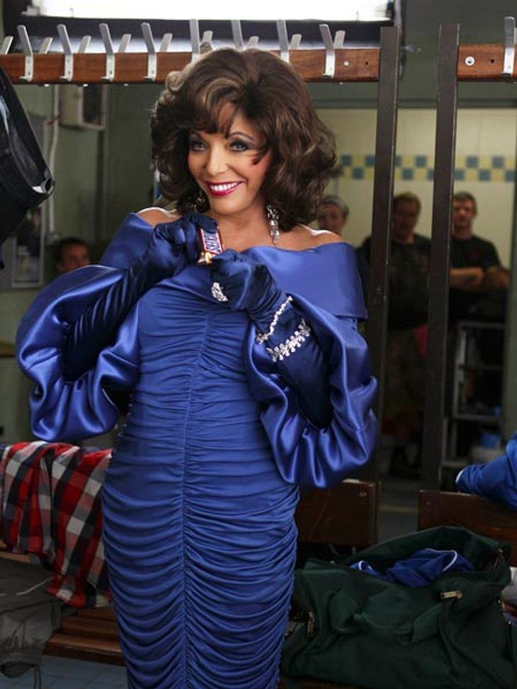 Joan Collins: Was eine Diva in der Handtasche haben sollte...Nun ist Joan Collins auch als Diva in einem Werbespot zu sehen. Perfekt verkörpert sie die zickige Diva, die nach dem Genuss eines Schokoriegels wieder zum Normalo wird.Unsere grö