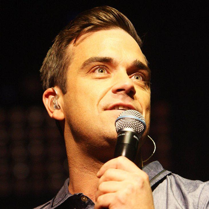 Robbie Williams plant, seiner britischen Heimat den Rücken zuzukehren