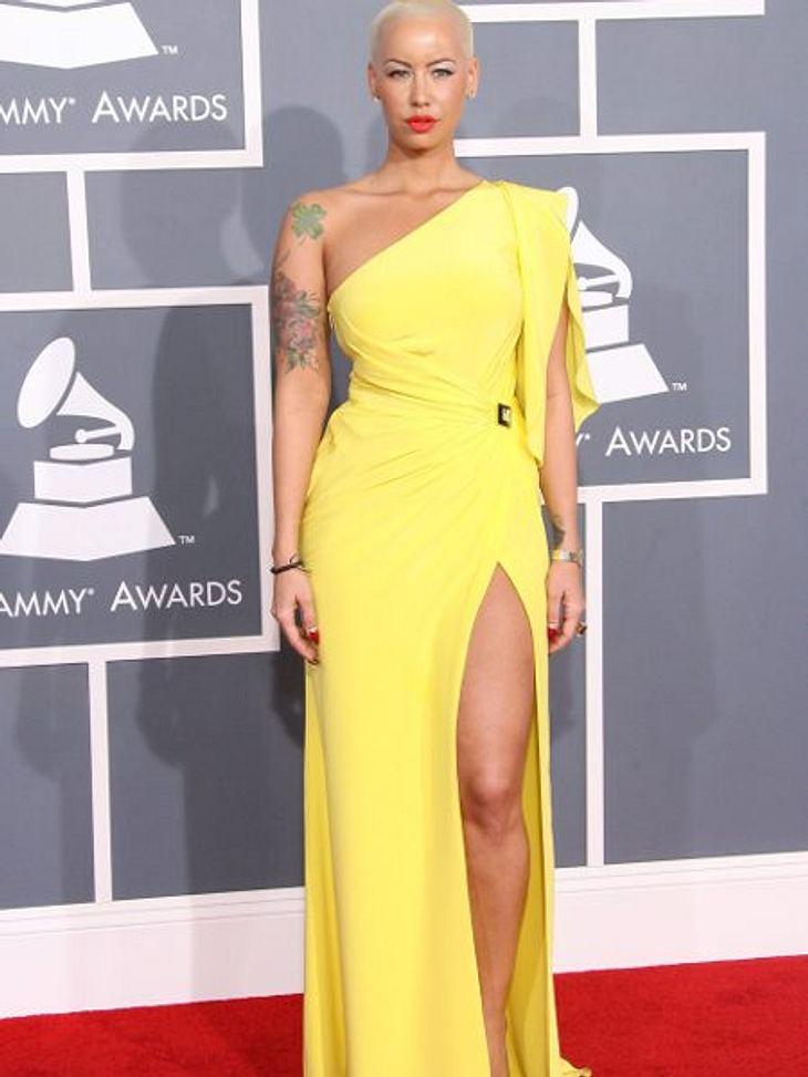 Star-Style: GelbAmber Rose (28) zeigt sich im gelben Abendkleid ungewöhnlich elegant. Sonst betont sie ihre kurvige Figur eher unvorteilhaft mit Catsuits und Skinny-Jeans.