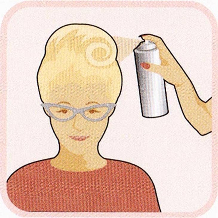 Mit Haarspray fixieren.