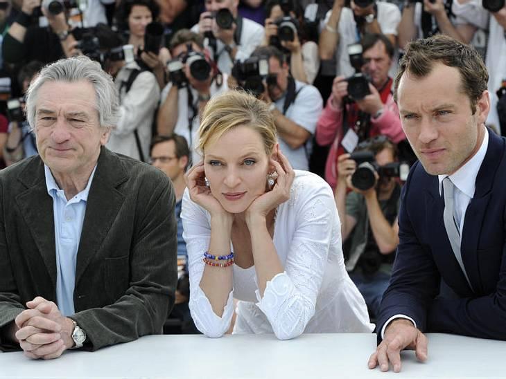 Cannes Uma Thurman, Robert De Niro (der Präsident der diesjährigen Jury) und Jude Law beim Photocall.