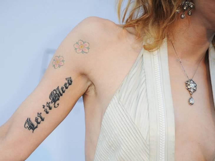 Cannes... auch ihre nicht sonderlich schönen Tattoos.