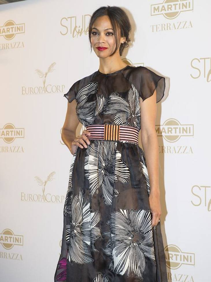 CannesKommen wir zu den Fashion-Fiaskos des 6. Cannes-Tages:Nummer 1: Zoe Saldana im Großmutter-Look.