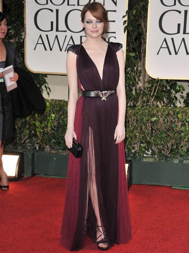 Der extravagante Look von Emma StoneMit Smokey-Eyes und in einem verführerischen, pflaumen- und himbeerfarbenen Tüllkleid von Lanvin schritt sie über den roten Teppich der diesjährigen Golden-Globe-Verleihung. Besonderes Detail: Der Gürtel