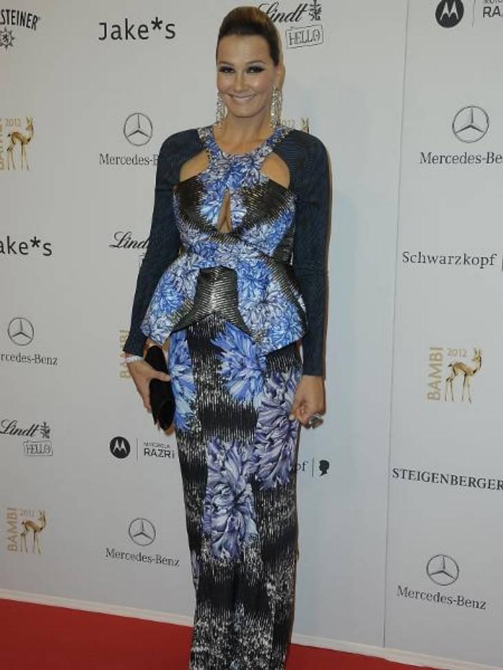 Bambi 2012 - Die Looks der StarsFranziska van Almsick (34) zeigte in ihrem figurbetonten Kleid erstmals ihren kleinen Babybauch.