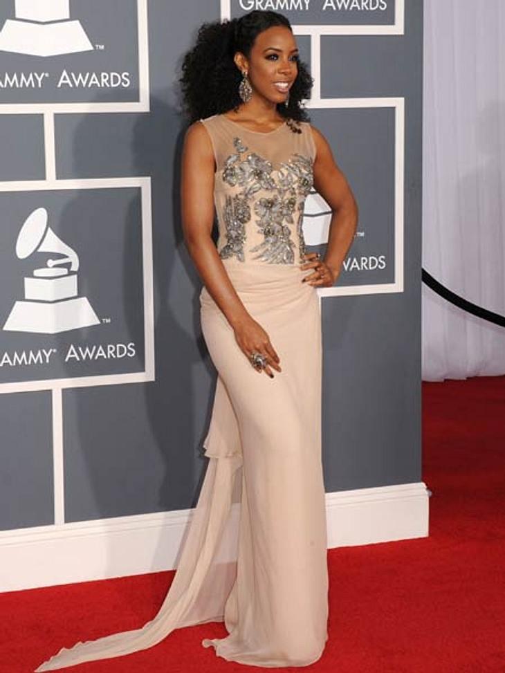Grammys 2012Kelly Rowland ganz alleine bei den Grammys. Busen-Freundin Beyoncé war zu Hause bei ihrem Baby.