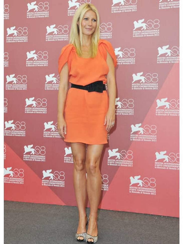 Star-Style: OrangeStyle-Vorbild Gwyneth Paltrow im kleinen Orangenen: Als Akzent trägt sie dazu einen schwarzen Schleifengürtel.