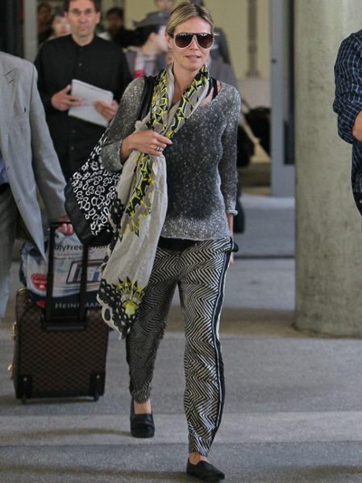"""Heidi Klum: Vom Topmodel zum Modemuffel""""Man muss immer überzeugt davon sein, dass man das Richtige macht"""", erklärt die Deutsche. Ein Outfit wie dieses aus Filzpulli, XL-Strandtasche und wilder Musterhose sollte man aber noch mal ü"""