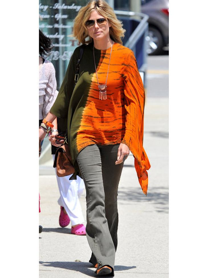 """Heidi Klum: Vom Topmodel zum ModemuffelHuch, unter den Walle-Walle-Poncho von Michael Kors hätte eine Röhre eindeutig besser gepasst. """"Ein hübsches Aussehen reicht nicht"""", findet sie. Richtig, das Styling sollte auch stimmen."""