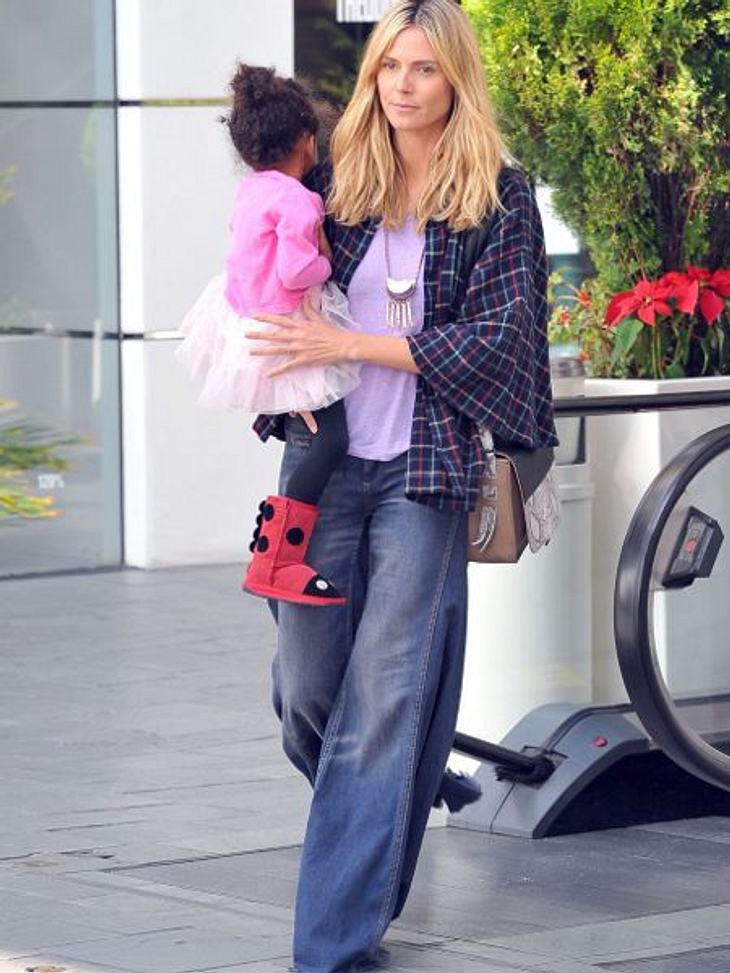 """Heidi Klum: Vom Topmodel zum ModemuffelHallo, Frau Landstreicherin, gab es nichts mehr in der passenden Größe? Die Jacke zusammen mit Shirt und Hose wirken viel zu groß. """"Seitdem ich Mama bin, bin ich entspannter"""", so Heidi. Nachl"""