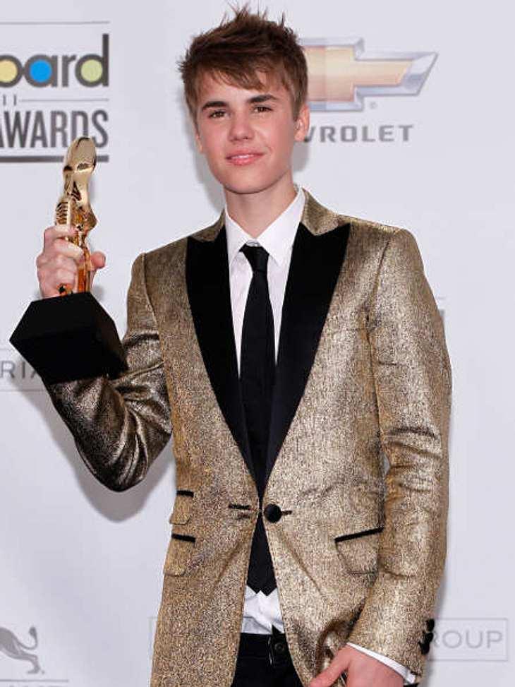 """Justin Bieber - Seine schönsten Momente: Mai 2011,Beim Anzugkauf könnte Justin Bieber aber noch Hilfe vertragen... Hier ist er bei den """"Billboard Music Awards"""" in Las Vegas."""