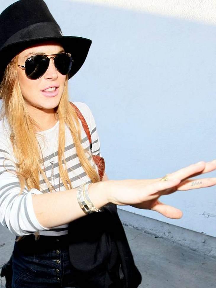 Tattoos: Diese Star-Bilder gehen unter die Haut Lindsay Lohan schmückt sich mit diesem unausgesprochenen Wort.