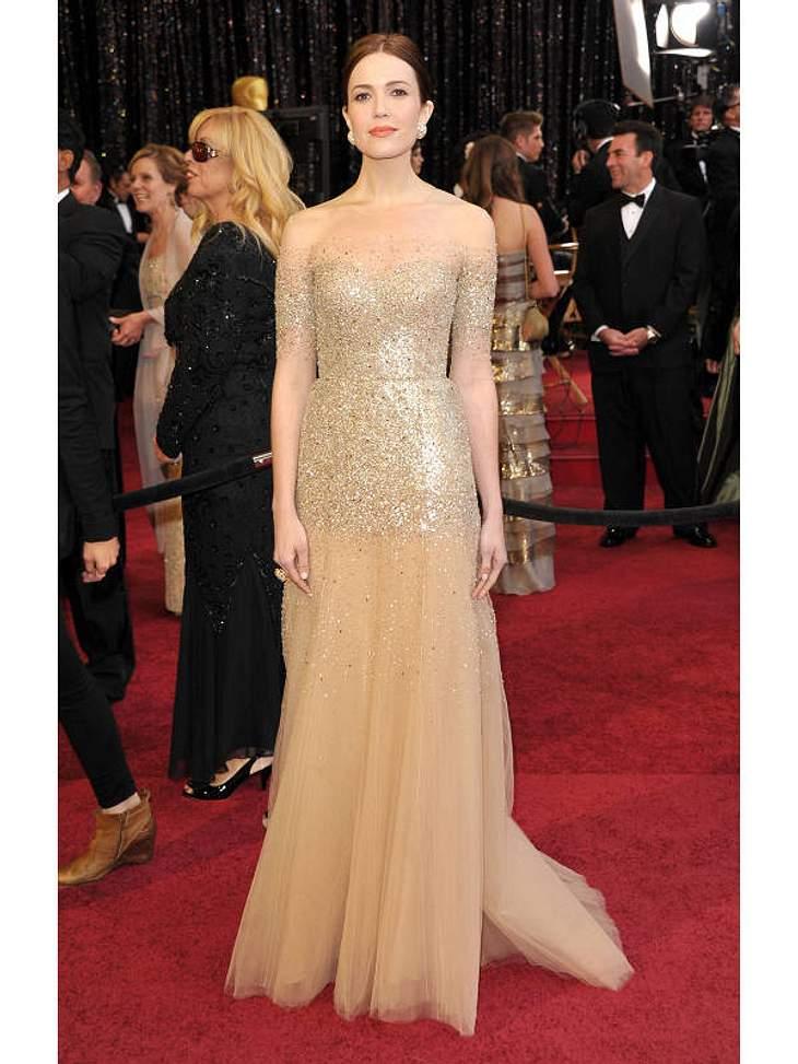 Oscar-Verleihung 2011: Auf dem roten Teppich trug Sängerin und Schauspielerin  Mandy Moore Gold, bei ihrem Auftritt auf der Oscarbühne erschien sie in einem blauen Traumkleid.