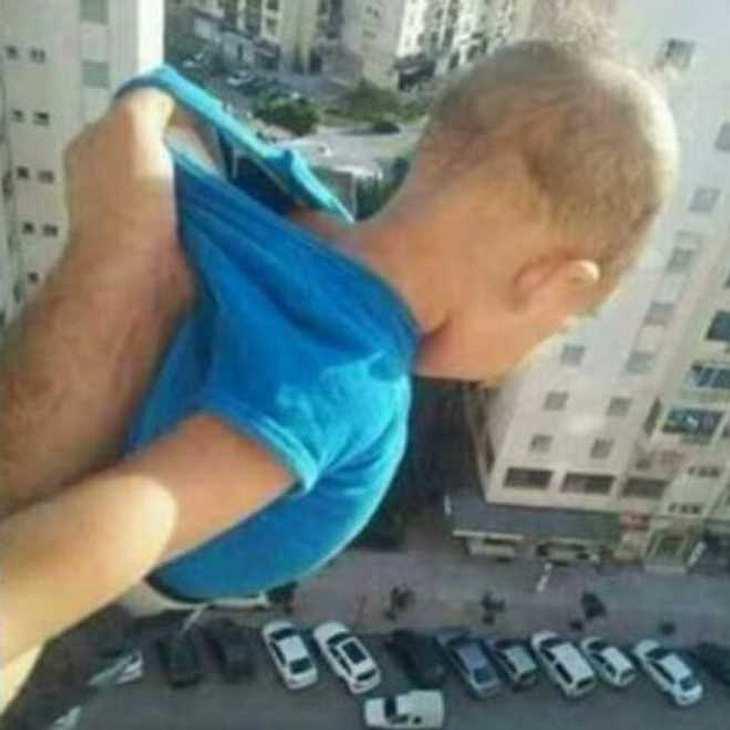 Mann hält Baby für Facebook-Likes aus dem Fenster im 15. Stock!
