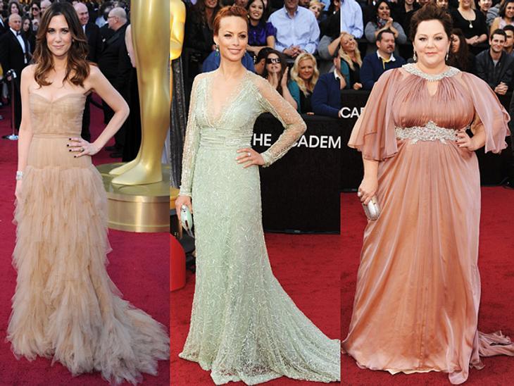 Die Kleider der Oscar-Verleihung 2012Kristen Wiig (38) in J. Mendel, Berenice Bejo (35) in Elie Saab und Melissa McCarthy (41) in Marina Rinaldi - allesamt verzauberten in hellen Pastelltönen.