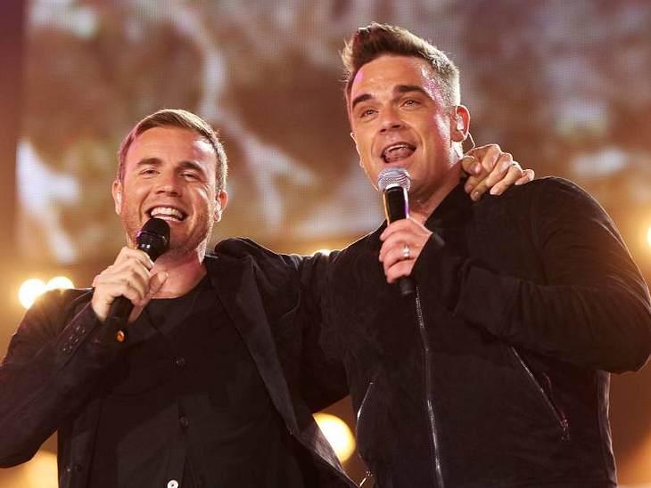 Robbie Williams und Gary Barlow bei ihrem ersten gemeinsamen Auftritt