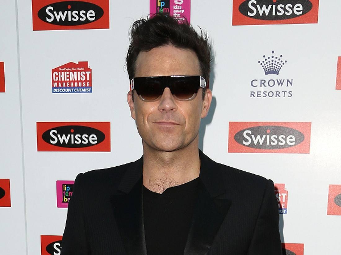 Robbie Williams mimt James Bond in neuer Kaffeewerbung