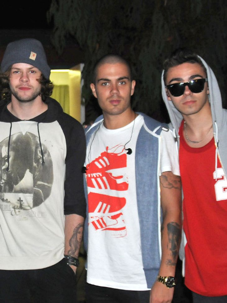 "Max George von ""The Wanted"" hält ""One Direction"" die Hand hin"