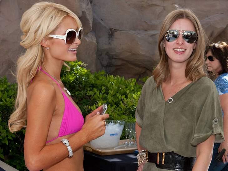 ,Urlaubsziele der Stars...auch Hilton Schwesterchen Nicky durfte schon mit in Paris' sommerliche Partyhochburg. Begeisterung sieht irgendwie anders aus...