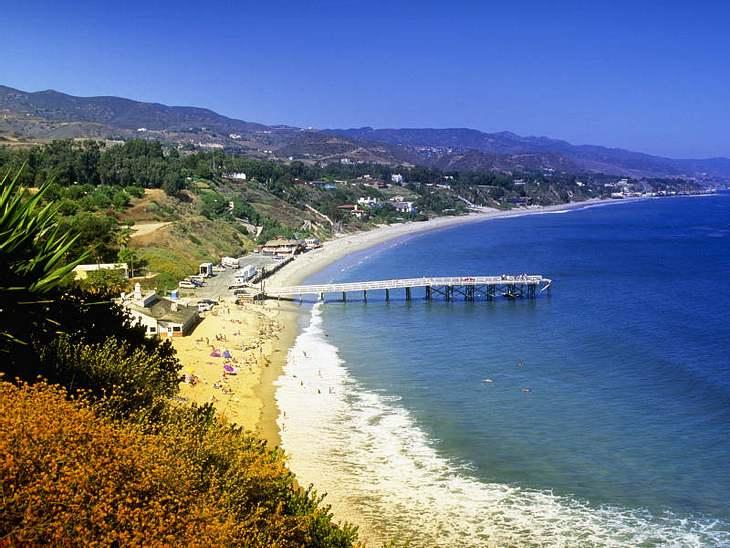 ,Urlaubsziele der StarsNur 100 Meter vom Pacific Coast Highway, finden sich Stars wie Muscheln am Meer. Die als Surf City bekannte Stadt ist Heimat für unzählige Hollywood-Promis.