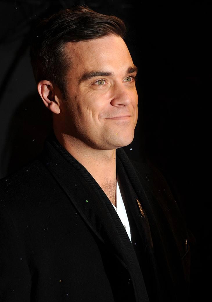 Robbie Williams denkt über Haiti-Adoption nach